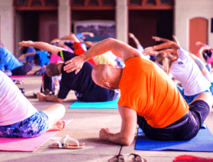 Man in exercise yoga class