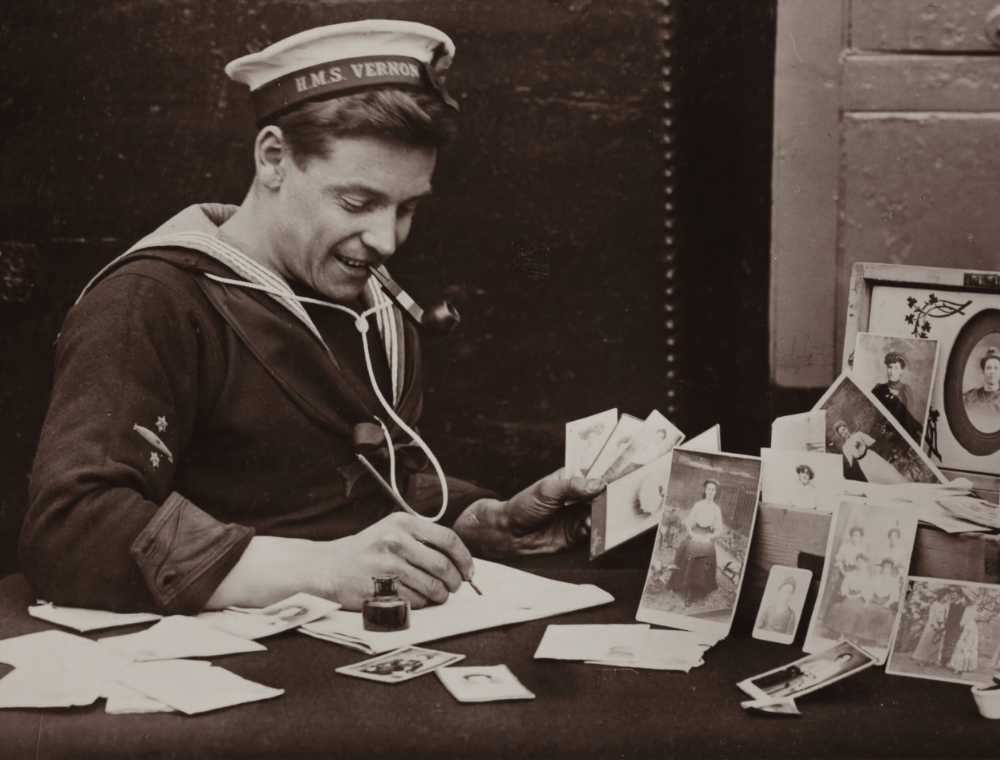 Old photograph of man writing letter