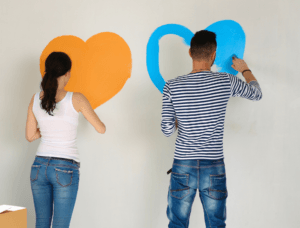 Couple Painting Hearts on Wall